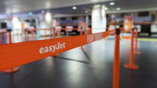 Les files d'embarquement vides de la compagnie aérienne Easyjet, le 4 avril 2020 à l'aéroport de Bâle-Mulhouse. [Georgios Kefalas - Keystone]
