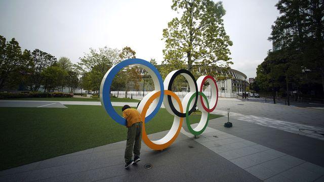 Le suspense continue de planer sur la tenue ou non des JO 2020, en 2021. [Eugene Hoshiko - AP]