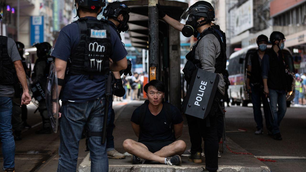 Des milliers de personnes ont envahi les rues de Hong Kong pour dénoncer un projet de loi chinois. [Jérôme Favre - Keystone]