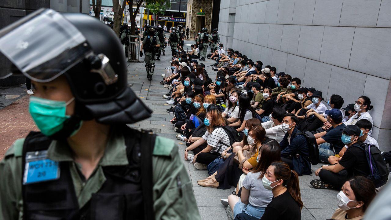 A Hong Kong, la police dissuade les manifestants pro-démocratie [Isaac Lawrence - AFP]