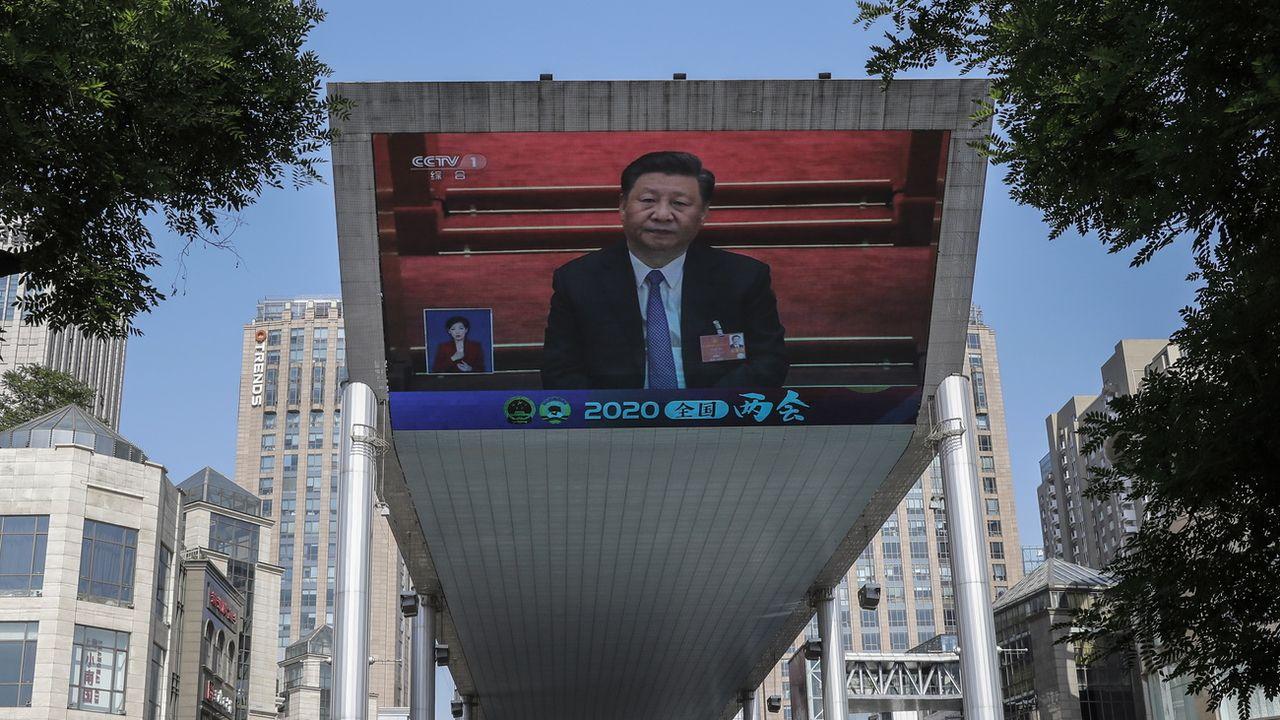 "La Chine promet une ""contre-attaque"" après les annonces de Trump. [EPA/Wu Hong / POOL - Keystone]"