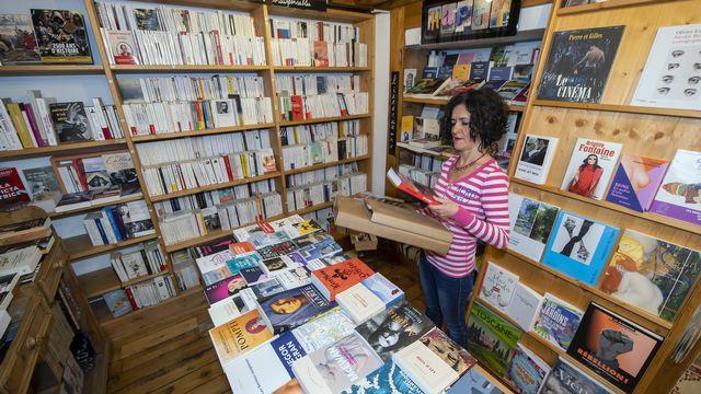 Les librairies indépendantes ont dû faire preuve d'ingéniosité pour pour survivre à la crise du Covid-19. [Martial Trezzini - Keystone]