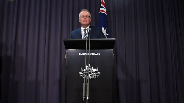 Le Premier ministre australien Scott Morrison lors d'une conférence de presse. [Mick Tsikas - EPA]