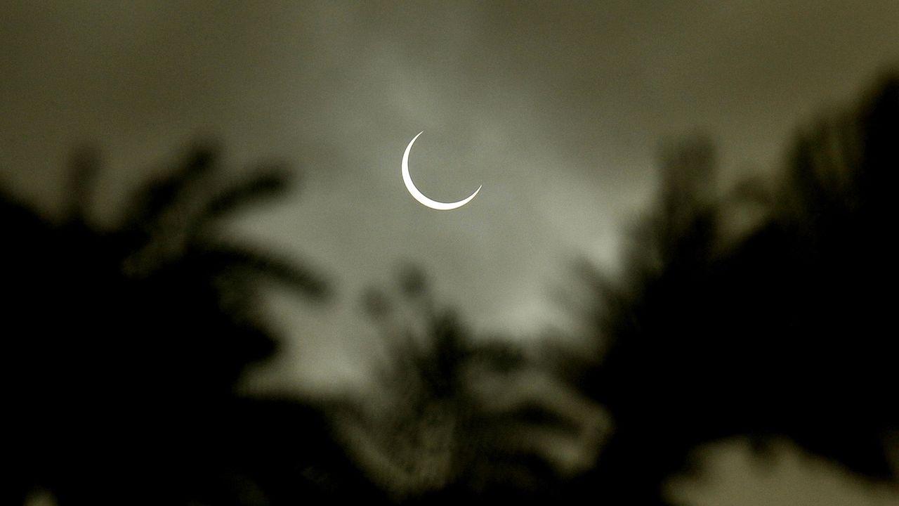"""L'éclipse """"cercle de feu"""" du 26 décembre 2019 vue de Mysore, en Inde. [Jagadeesh NV - EPA/Keystone]"""