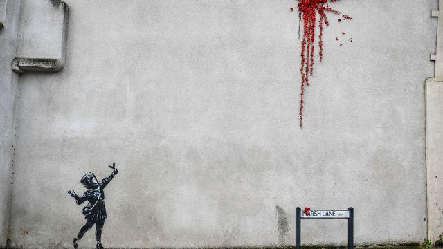 Une oeuvre attribuée à Banksy dans les rues de Bristol, en Angleterre. [Ben Birchall - AFP]