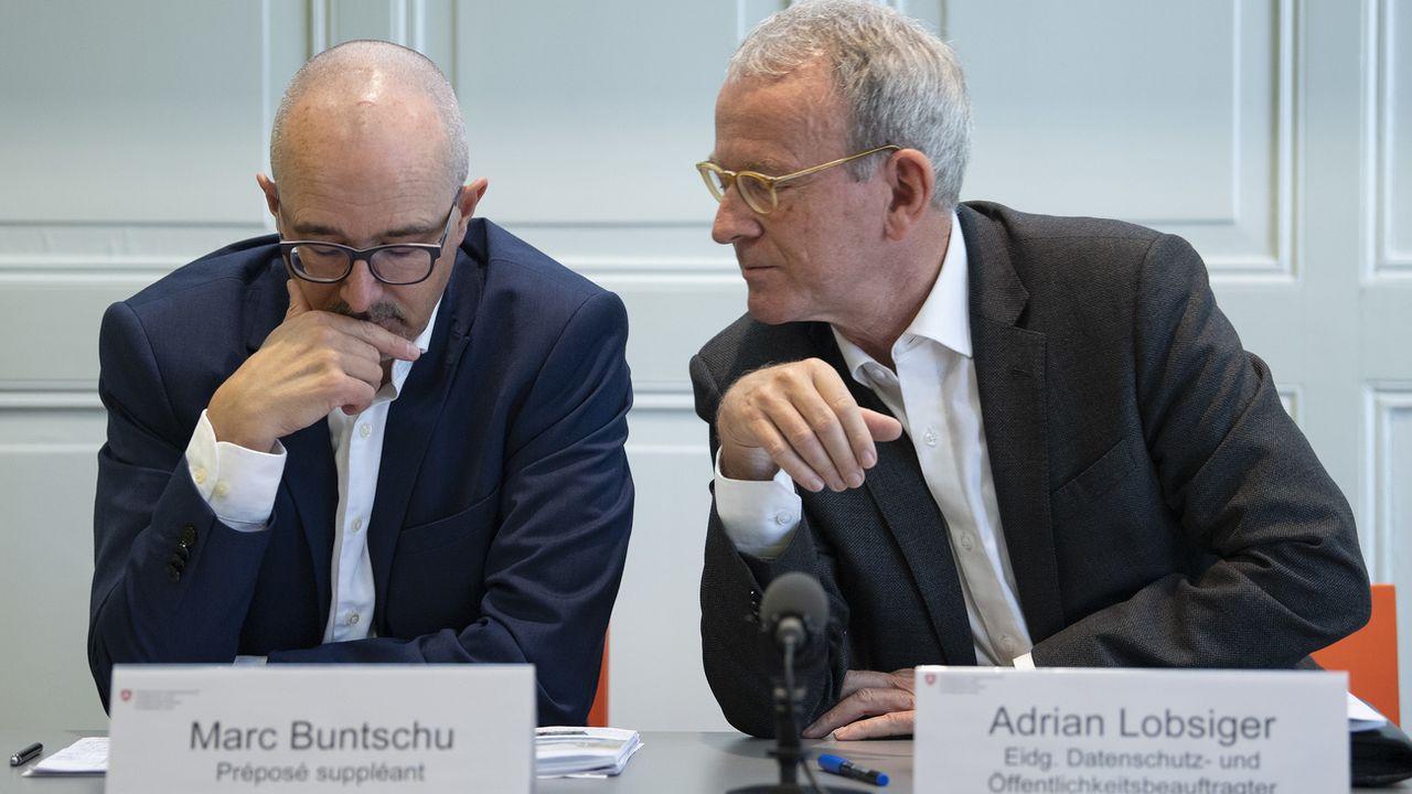 Le préposé fédéral Adrian Lobsiger (droite) et son suppléant Marc Buntschu. [Peter Schneider - Keystone]