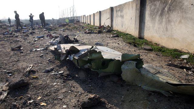 "Une ""erreur humaine"" est à l'origine du drame du Boeing ukrainien abattu. [Abed In Taherkenareh - Keystone/EPA]"