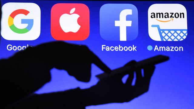 """La France est le premier État à introduire en Europe une """"taxe Gafa"""" (Google, Amazon, Facebook, Apple). [Damien Meyer - AFP]"""