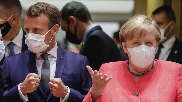 Emmanuel Macron et Angela Merkel sont présents à Bruxelles. [Stephanie Lecocq - AFP]