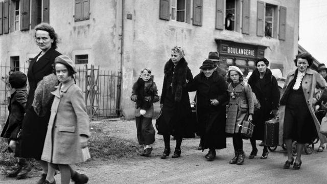 Des réfugiés français à la frontière des Verrières (NE) lors de la Seconde guerre mondiale. [Photopress-Archiv - Keystone]