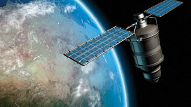 Un satellite en orbite terrestre.  [AP Photo/NASA - Keystone]