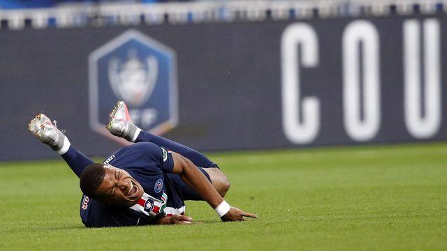 La participation de Mbappé au quarts de finale d e la Ligue des champions est très incertaine. [Yoan Valat - Keystone]