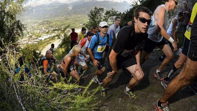 Concurrents sur le parcours de Sierre Zinal en 2013 [Laurent Gillieron - Keystone]