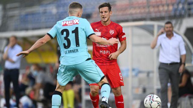 Vaduz et Thoune se disputent une place en Super League. [Gian Ehrenzeller - Keystone]