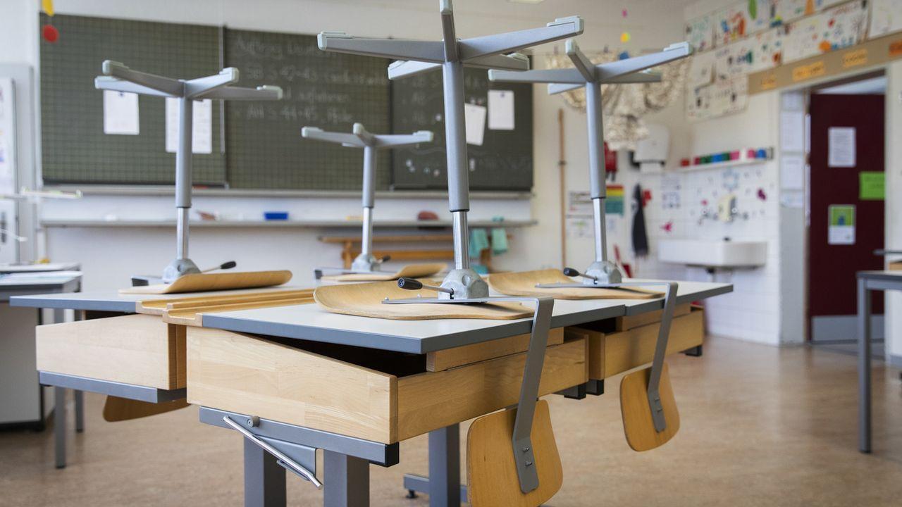 16 mars: des écoles sans élèves et des écoles à la maison deviennent la norme. [Peter Klaunzer - Keystone]