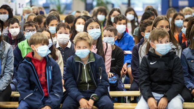 Que faire si un enfant présente des symptômes du virus en classe?  [Alexandra Wey - Keystone]