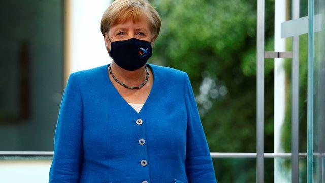 Angela Merkel fait le point sur la pandémie devant la presse à Berlin. [DPA/Michele Tantussi - Keystone]