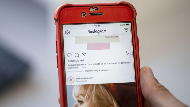 Un écran ouvert sur l'application Instagram. [Christian Beutler - Keystone]