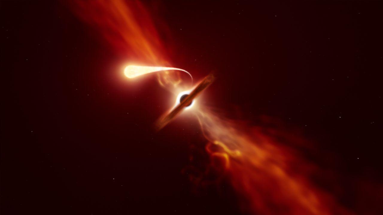 """Spaghettisation d'une étoile: elle est aspirée par un trou noir supermassif (en arrière-plan) lors d'un """"événement de rupture par effet de marée"""". Résultat: l'éjection d'un puissant jet de matière vers l'extérieur du trou noir. [M. Kornmesser - ESO]"""