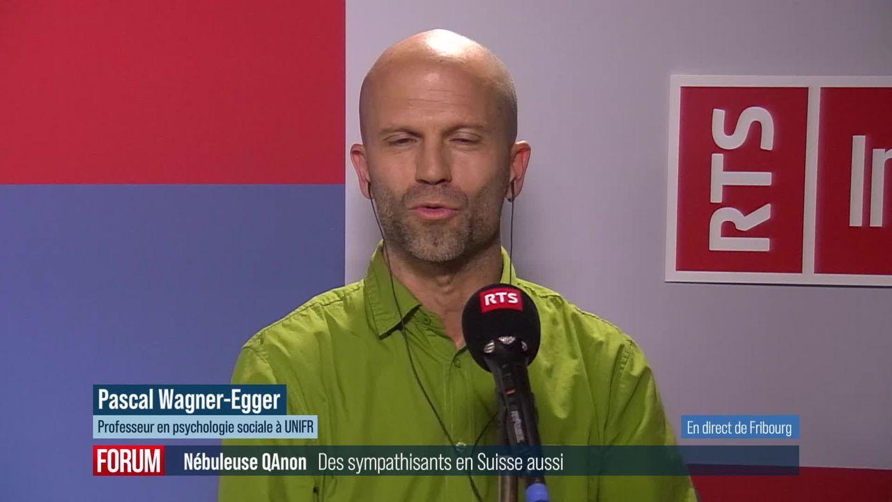 La nébuleuse conspirationniste QAnon a des sympathisants en Suisse : interview de Pascal Wagner-Egger [RTS]
