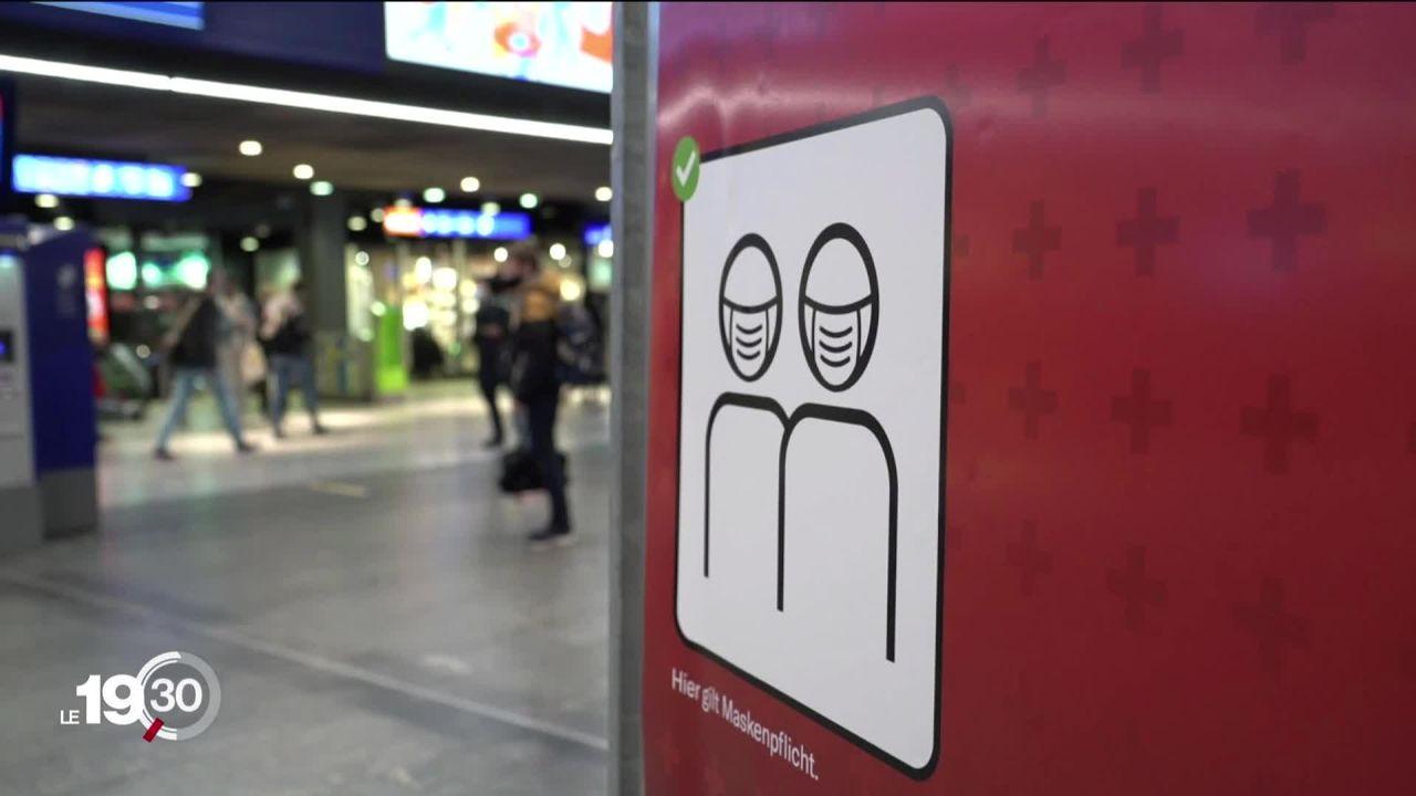 Le port du masque se généralise. 9 cantons ont annoncé aujourd'hui l'obligation du masque dans les lieux publics. [RTS]