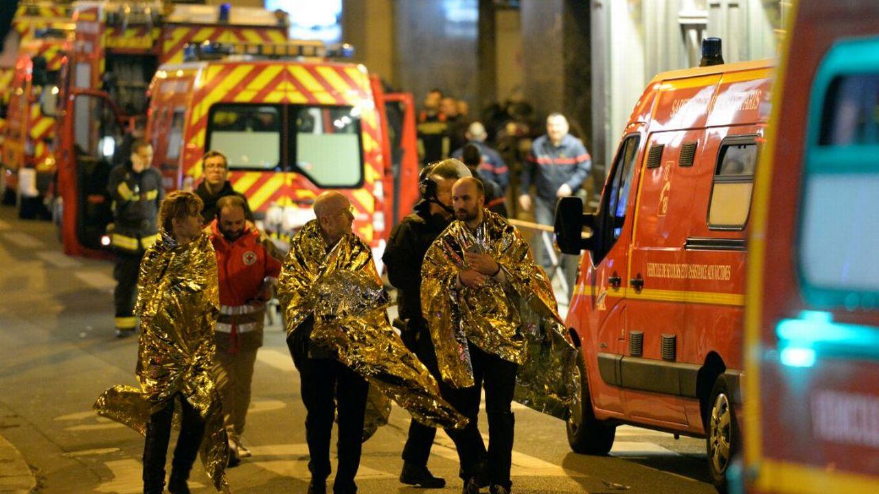 Des victimes du Bataclan le soir du 13 novembre 2015. [Miguel Medina - afp]