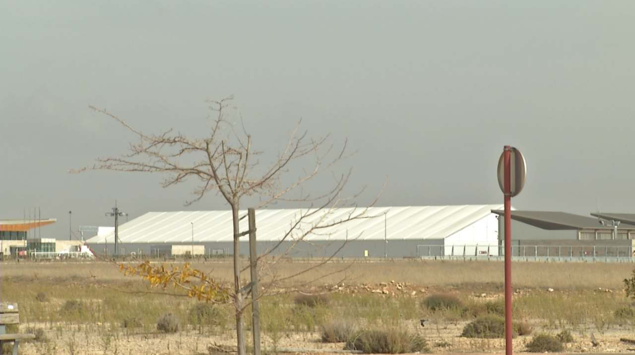The Solar Impulse 2 aircraft is reassembled under this hangar at Albacete airport in Spain, out of sight.