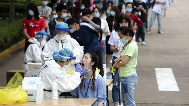 Nouvelles révélations de CNN sur l'apparition du Covid-19 en Chine. [Chinatopix/AP/Keystone]