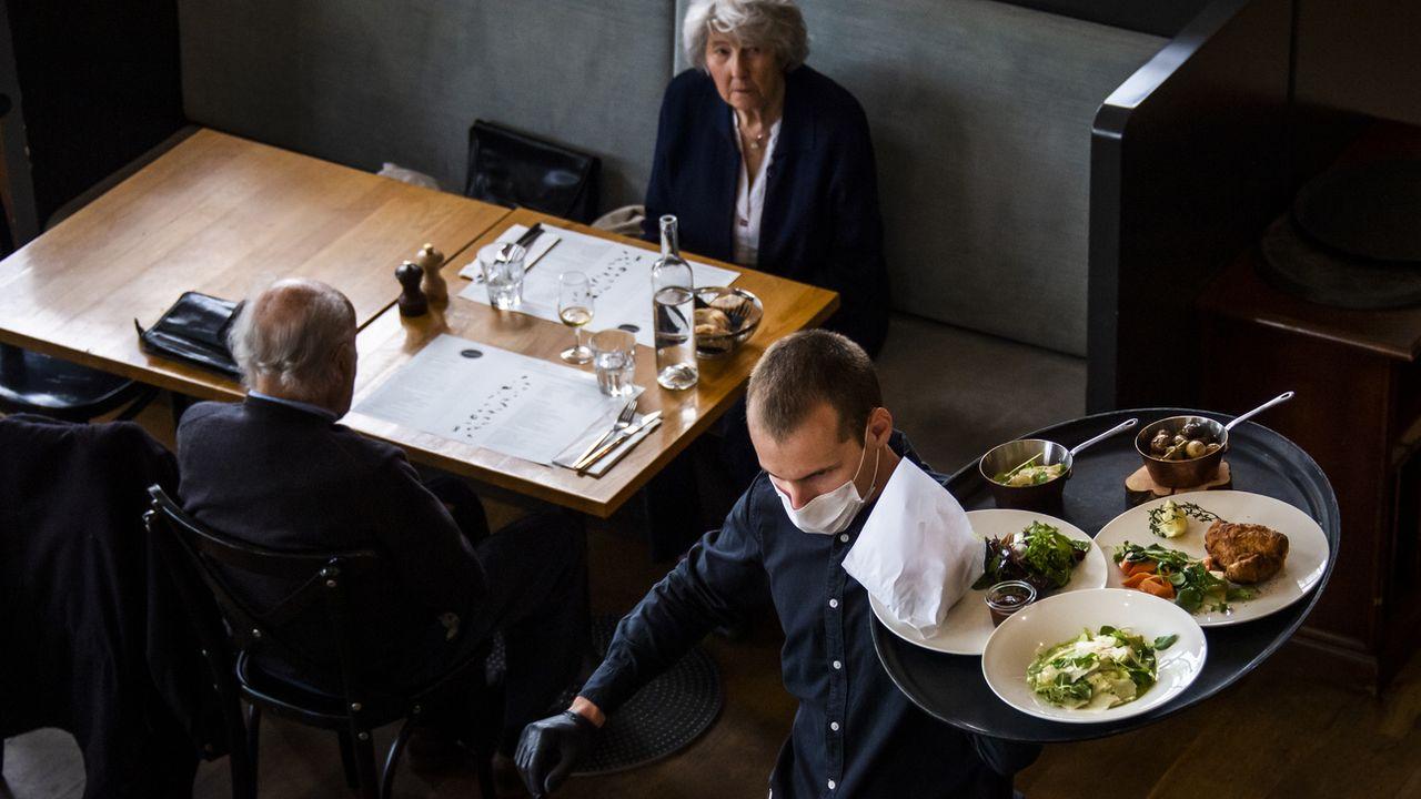 Le réouverture des restaurants est très strictement encadrée. [Jean-Christophe Bott - Keystone]