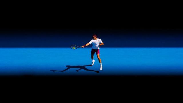 Roger Federer, entre ombre et lumière. [Scott Barbour - AP]