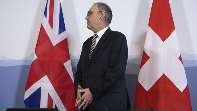 La Suisse (ici, Guy Parmelin) a déjà signé divers accords avec Londres. [Peter Klaunzer - Keystone]