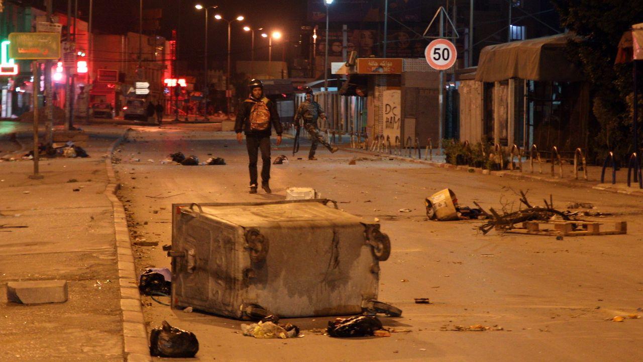 La Tunisie a connu une troisième nuit d'émeutes. [STR - Keystone/EPA]