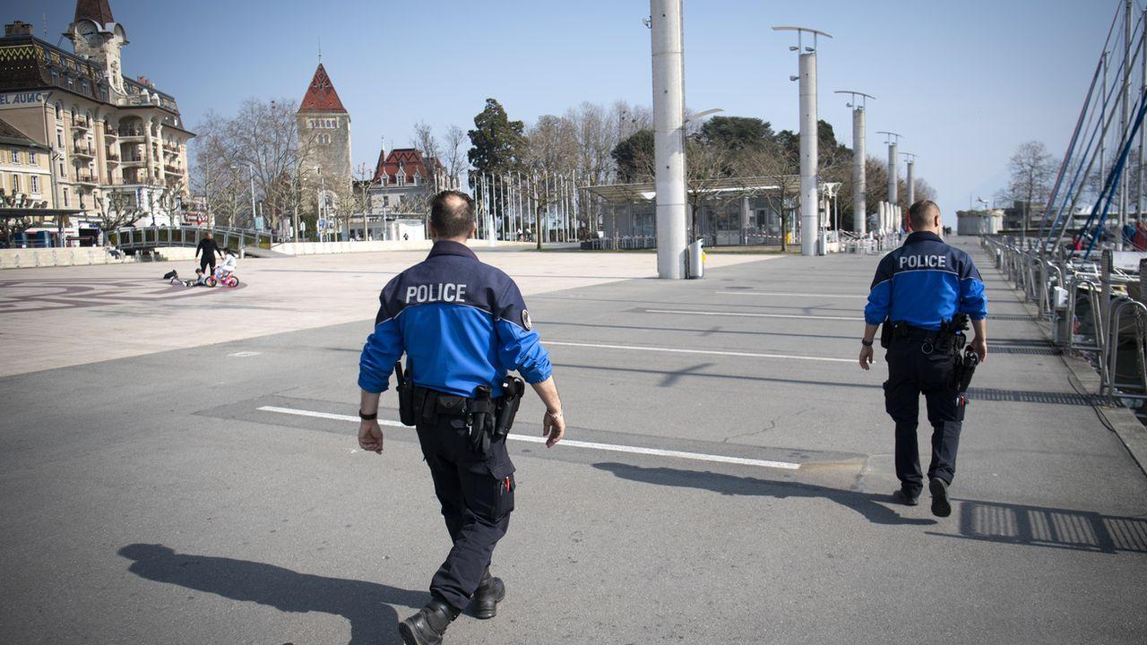 Des policiers patrouillent à Lausanne (Image d'illustration) [Laurent Gillieron - Keystone]