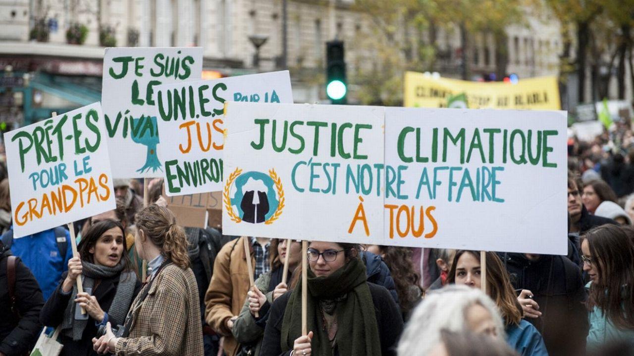 Une manifestation pour la justice climatique en décembre 2018 dans les rues de Paris. [Magali Cohen - Hans Lucas via AFP]