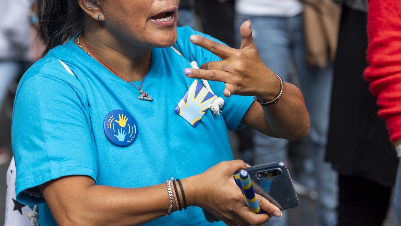 Une personne sourde à l'occasion de la Journée mondiale des sourds en septembre 2018. [Martial Trezzini - Keystone]