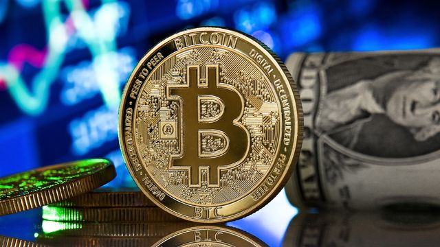 Un record à 50'000 dollars pour le bitcoin. [SASCHA STEINBACH - EPA]