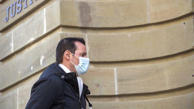 Pierre Maudet arrive au Palais de Justice. [Martial Trezzini - Keystone]