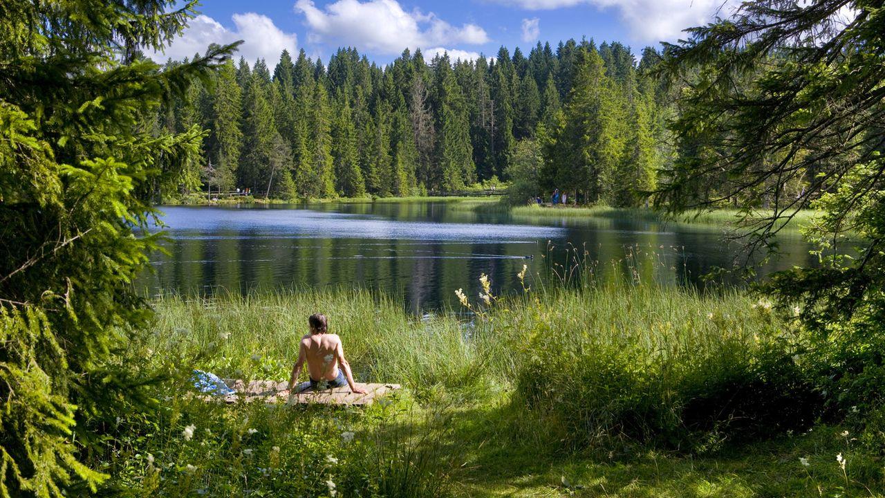 L'étang de la Gruère, dans le canton du Jura, attire quelque 150'000 personnes par année. [Martin Ruetschi - Keystone]