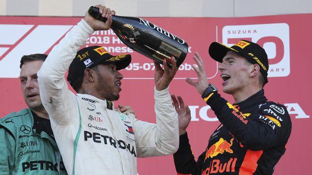 Max Verstappen (à droite) sera le principal adversaire de Lewis Hamilton (à gauche) cette saison. [Ng Han Guan - Keystone]