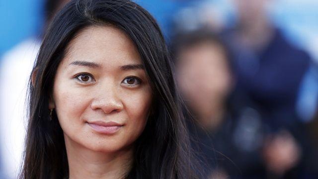 Nominée pour les Oscars, la cinéaste américano-chinoise Chloé Zhao a remporté le Lion d'or à Venise. [Nina Prommer - EPA/Keystone]