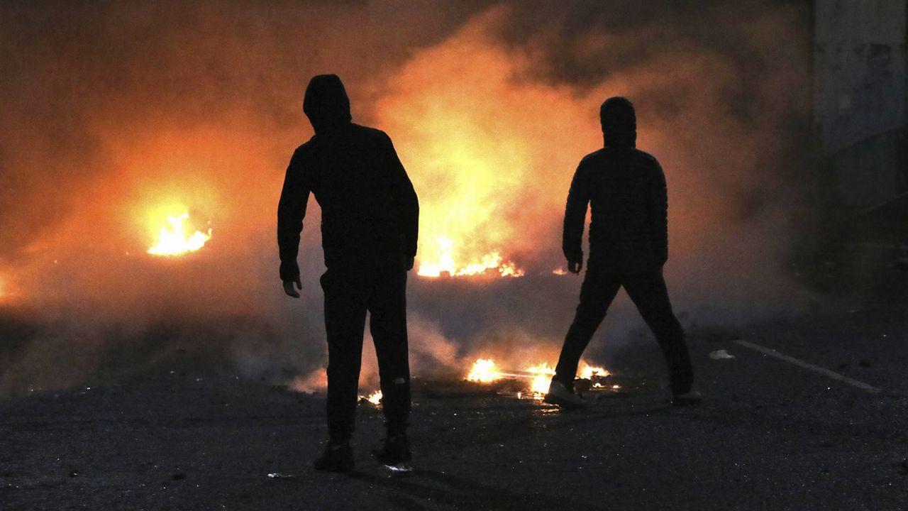 Nouvelle poussée de violences en Irlande du Nord. [Peter Morrison - Keystone]