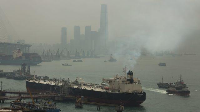 Un bateau dans le port de Hong Kong. [EPA/Jérôme Favre - Keystone]