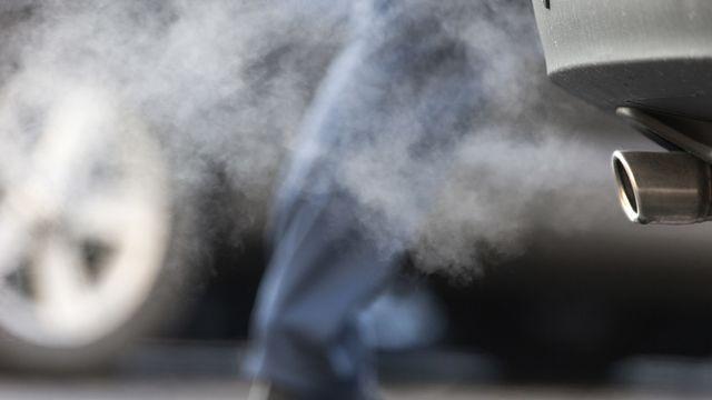 Les Suisses et Suissesses se prononcent le 13 juin sur la loi CO2. [Gaetan Bally - Keystone]