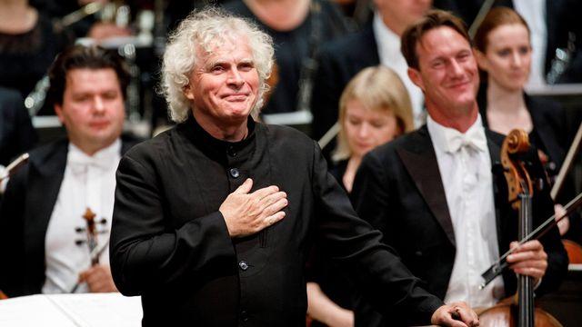 Le chef d'orchestre Simon Rattle. [Tolga AKMEN - AFP]