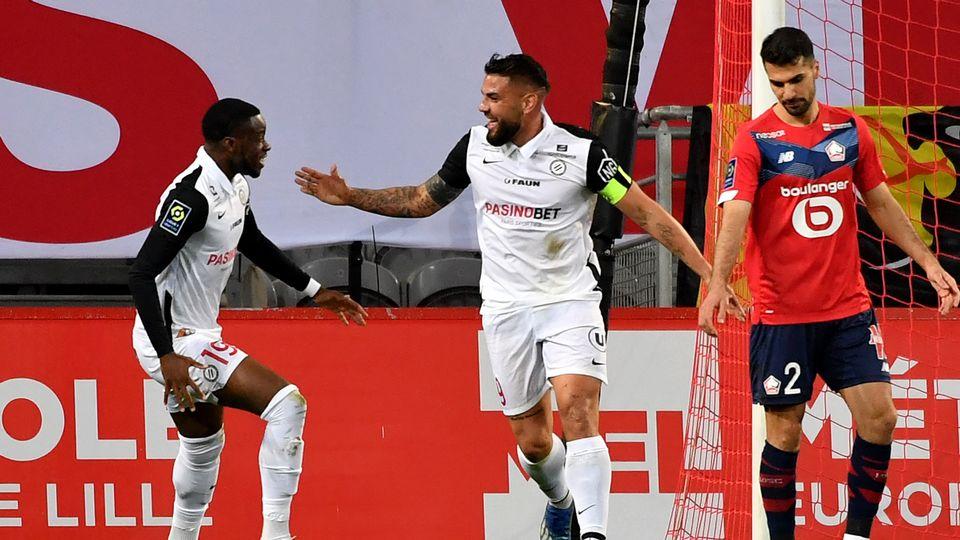 Andy Delort se marre. Montpellier a freiné le leader lillois. [AFP]