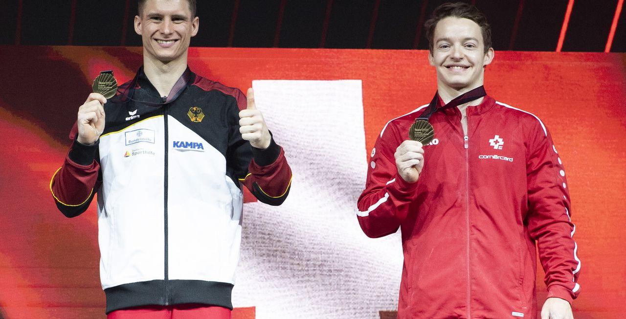 Baumann (à droite) complète la belle moisson suisse dans ces joutes à domicile. [Georgios Kefalas - Keystone]