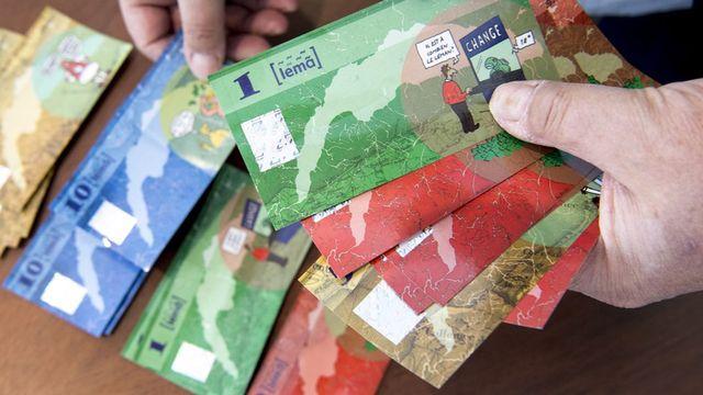 Finance et durabilité: quel avenir pour les monnaies locales? [Laurent Gillieron - Keystone]