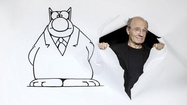 Le dessinateur belge Philippe Geluck et son fameux Chat. [Joël Saget - AFP]