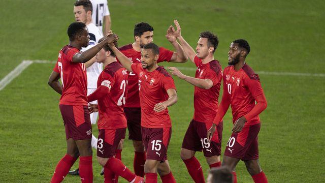 L'équipe de Suisse, au temps du bonheur, après une victoire sur la Finlande. [Gaetan Bally - Keystone]