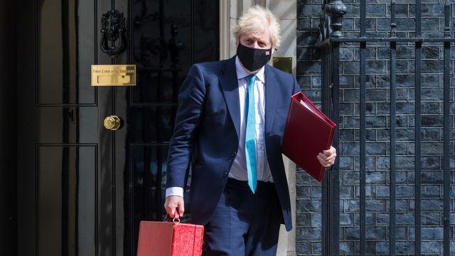 Le Premier ministre britannique, Boris Johnson, quitte le 10 Downing Street pour se rendre au Parlement. Londres, le 11 mai 2021. [Vickie Flores - Keystone/epa]